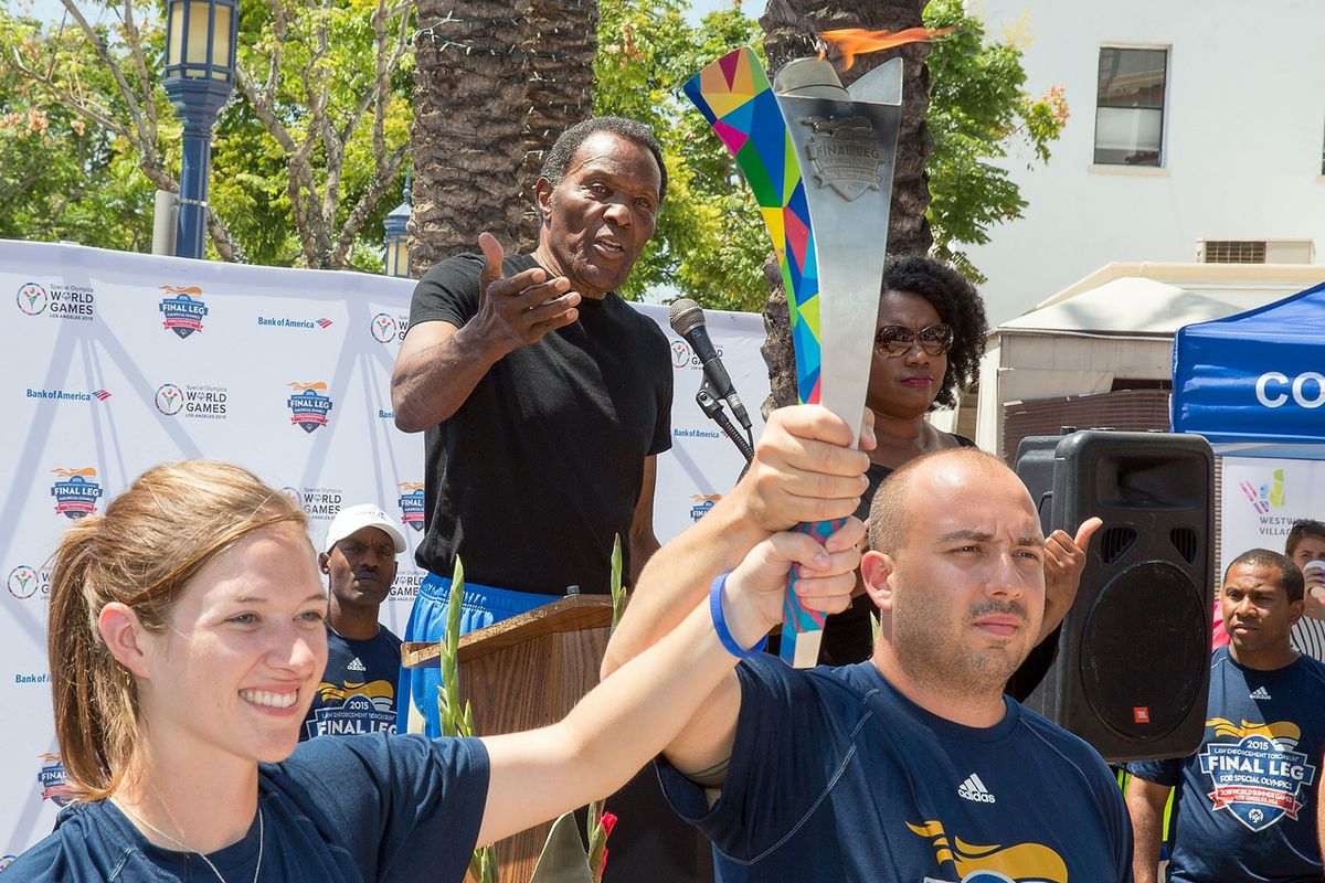 Rafer Johnson and Special Olympics torch