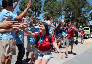 Click to open the large image: UCLA volunteers welcome the Special Olympics delegation from Austria