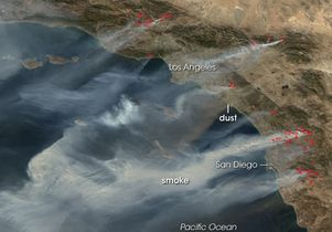 Santa Ana winds push wildfires
