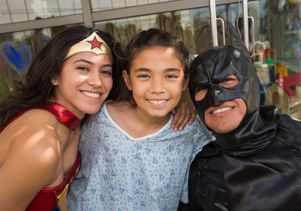 Patient Sky Assaf with Wonder Woman and Batman