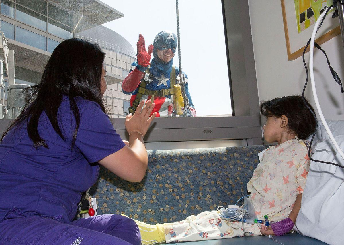 Captain America greets a patient