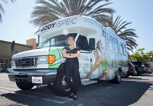 Elaine Shi and one of BodySpec's trucks