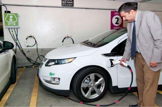 Engineering professor Rajit Gadh fuels an electic car
