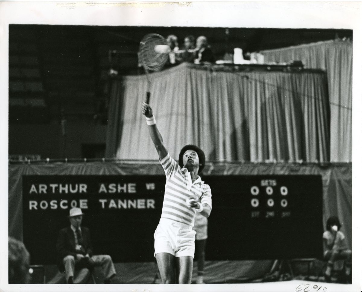 Arthur Ashe playing tennis in Pauley Pavilion