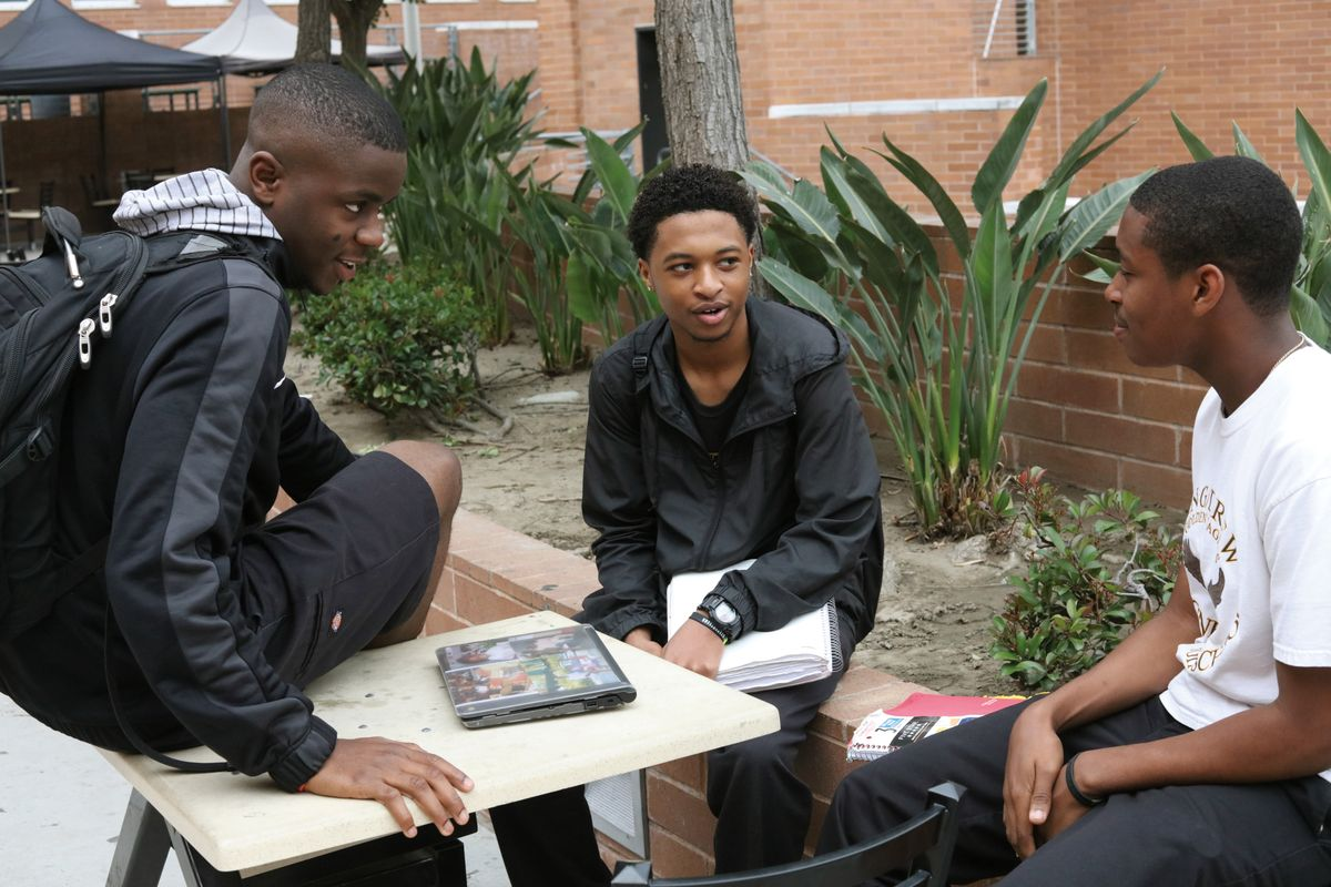 Young black men in discussion