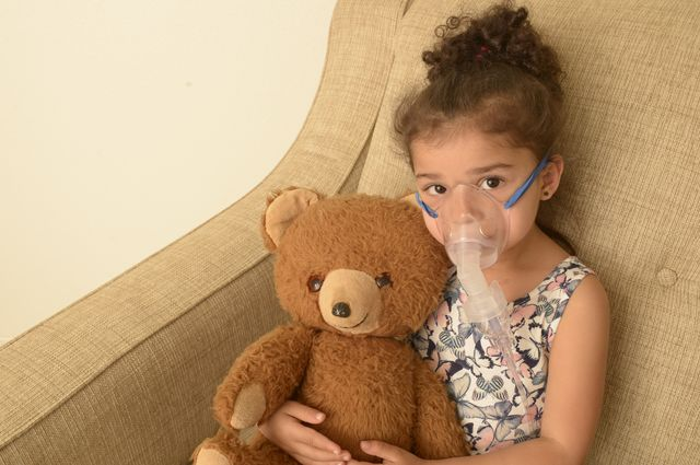 Young girl with oxygen
