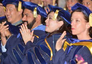 New Ph.D.s applaud