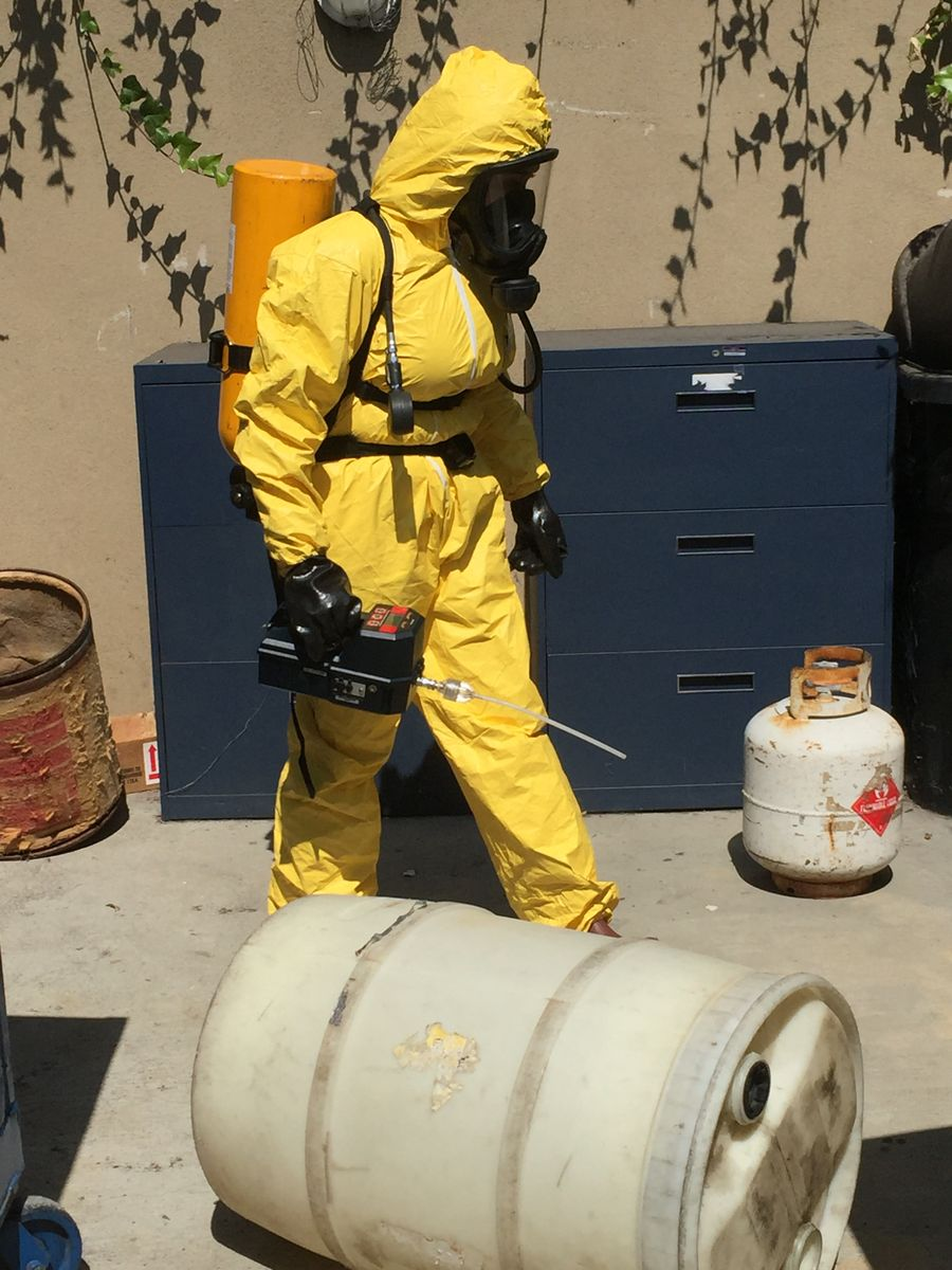 Trainee in a course for safe hazardous waste handling