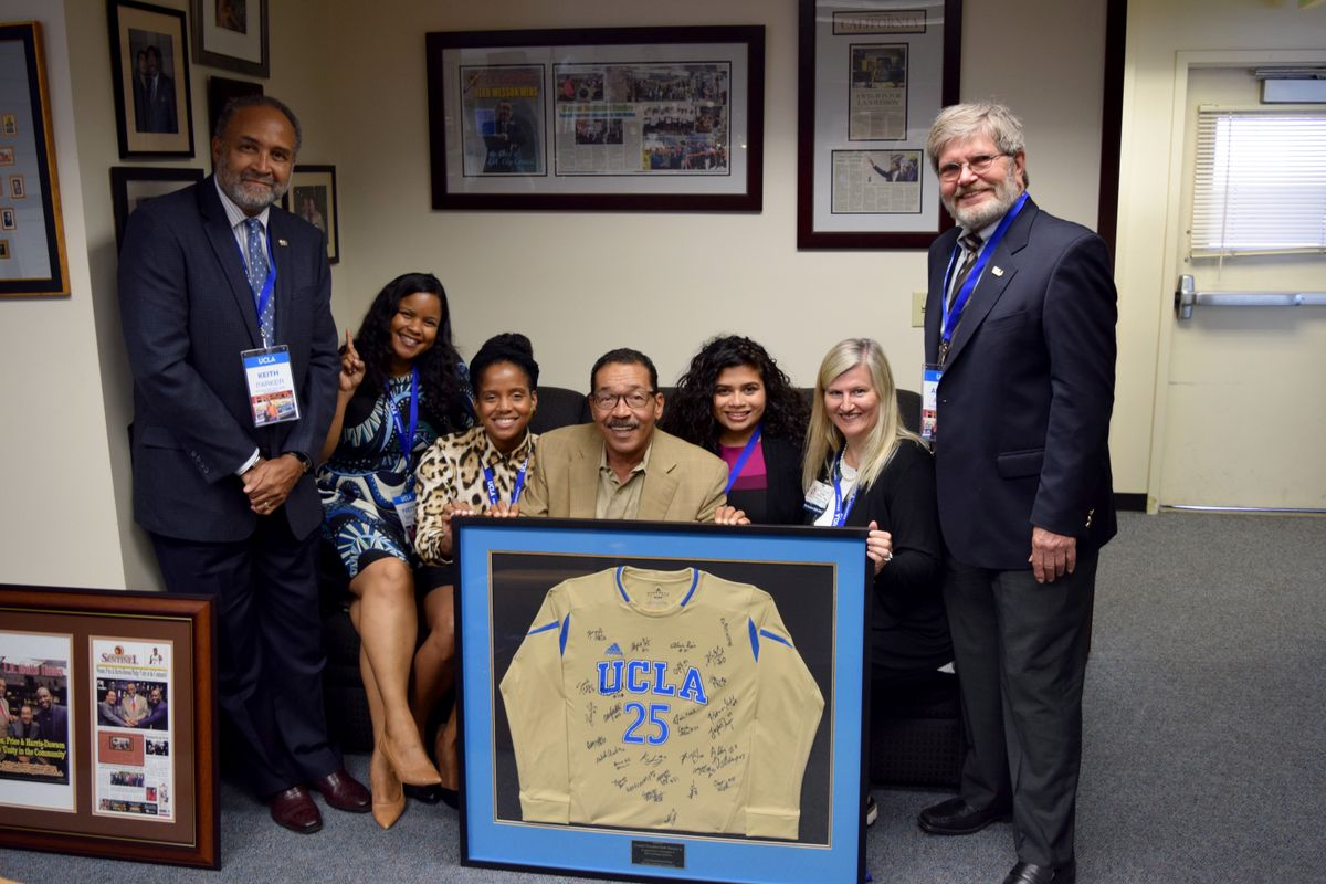 Herb Wesson, center, and visitors from UCLA