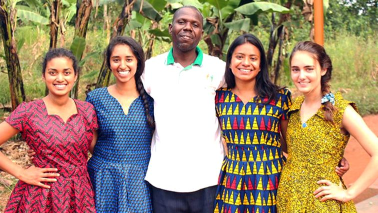 Four UCLA student interns in Uganda with the manager of Mpoma Community HIV/AIDS initiative