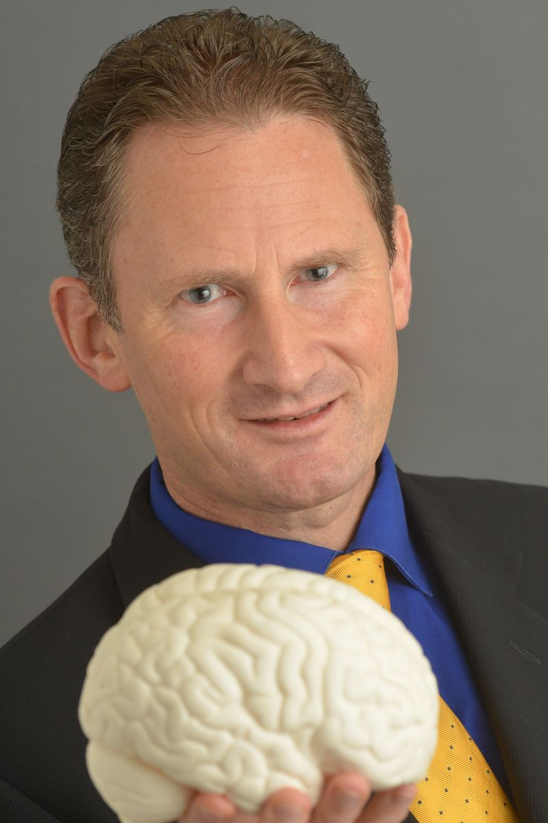 Paul Macey with model of a brain