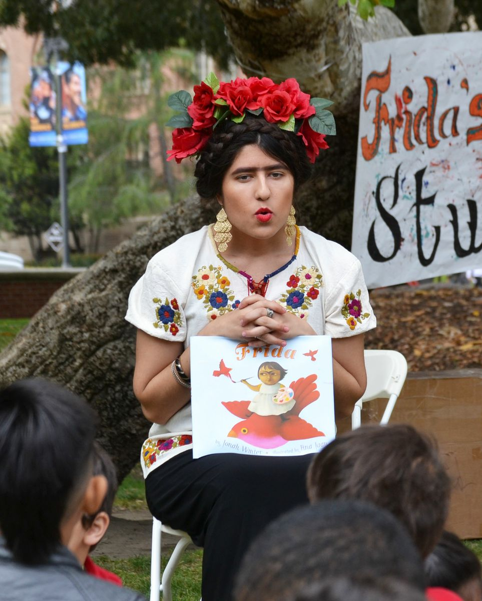 Angelica Castro reads to children