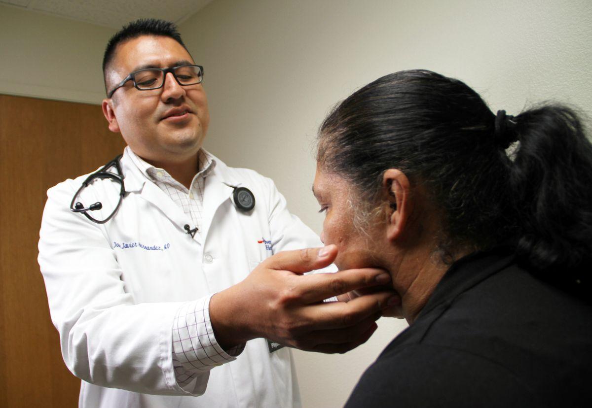 Dr. Jose Javier Hernandez examines a patient