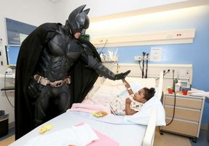 Superhero window washers visit young patients