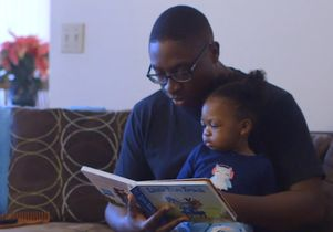 Click to open the large image: Dr. Amubiyea with daughter
