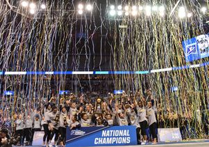 UCLA gymnastics team with streamers