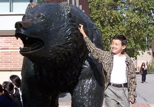 Click to open the large image: Kevin Herrera and the Bruin statue