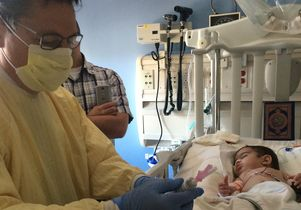 Click to open the large image: Hussein during stem cell transplant