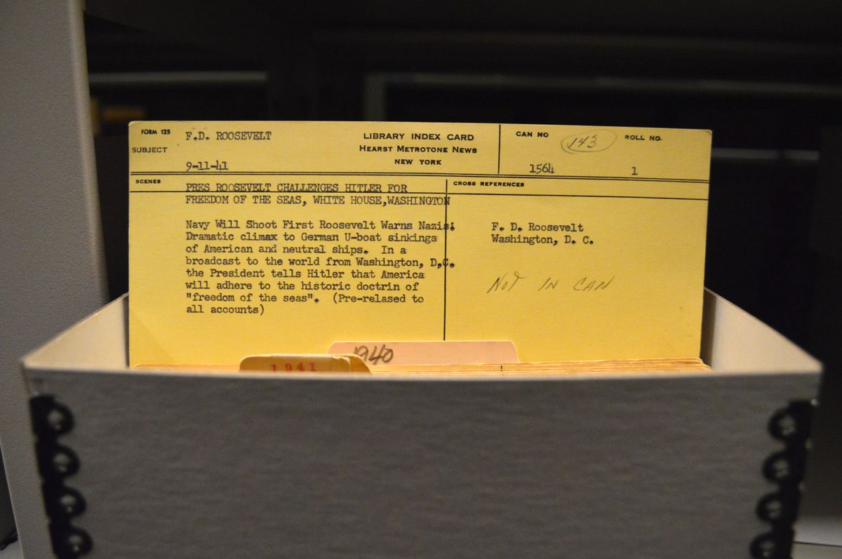 Yellow cardboard Hearst Metrotone News index card from 1941
