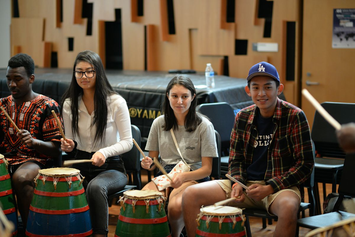 UCLA students try their hand at Ghanaian drumming during a workshop.