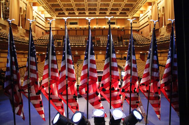 U.S. flags on Royce Hall stage