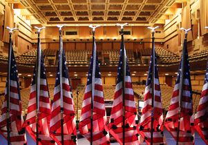 U.S. flags on Royce Hall stage