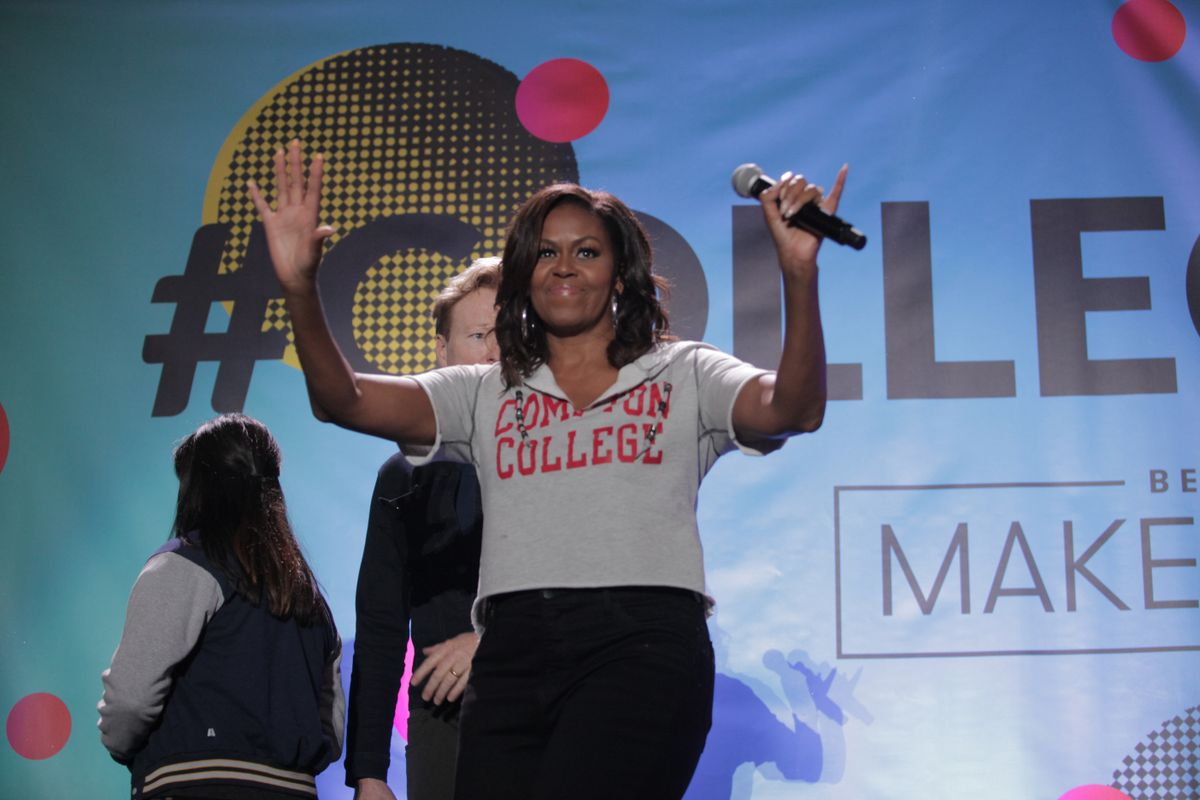 Michelle Obama waves to crowd