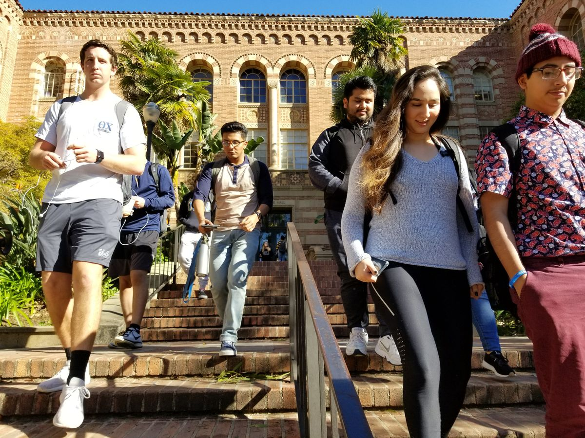 Students walking Moore Hall