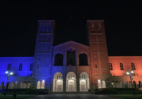 Royce Hall lit in blue
