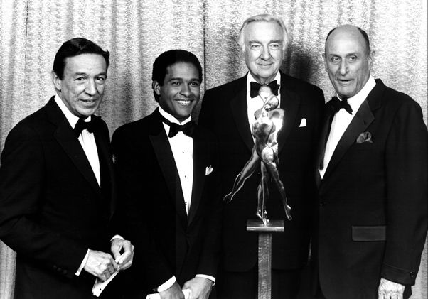 Mike Wallace, Bryant Gumbel, Walter Cronkite and John H. Mitchell