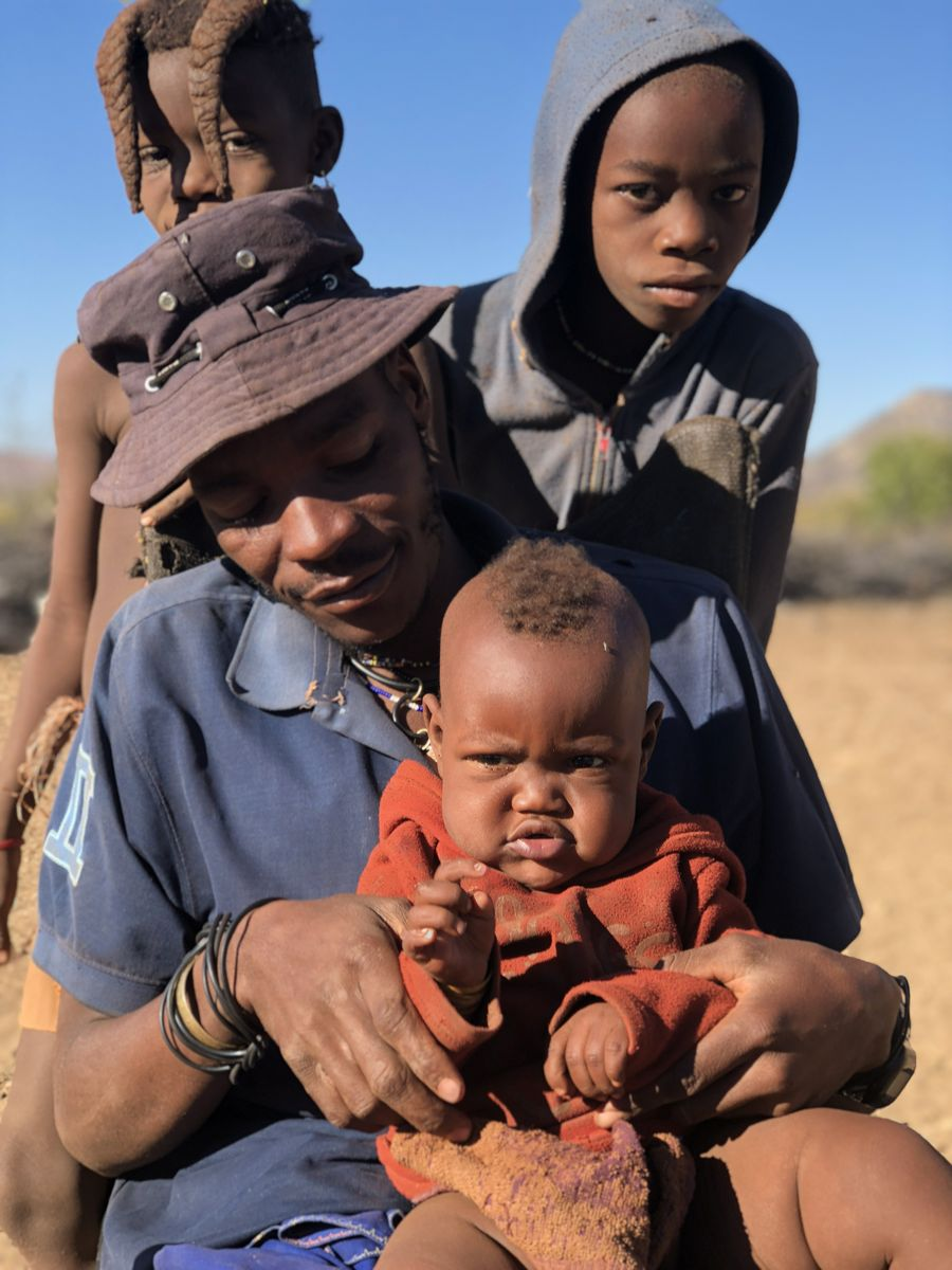 Himba father and his children