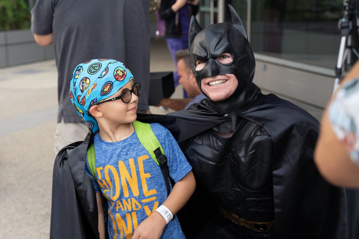 Batman and a child at UCLA Mattel Children's Hospital