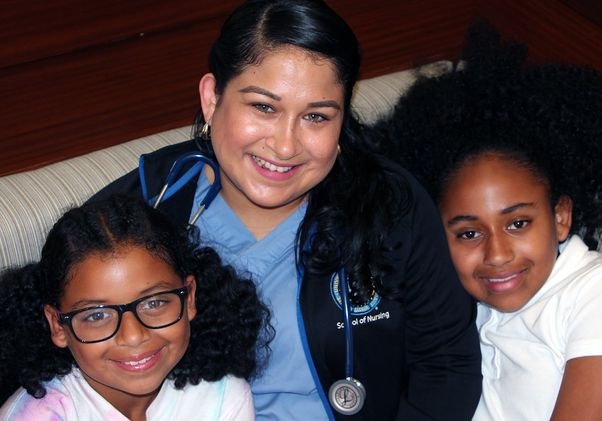 Click to open the large image: Jessica Chavez and daughters
