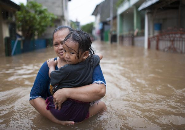 Woman and child in Jakarta flood