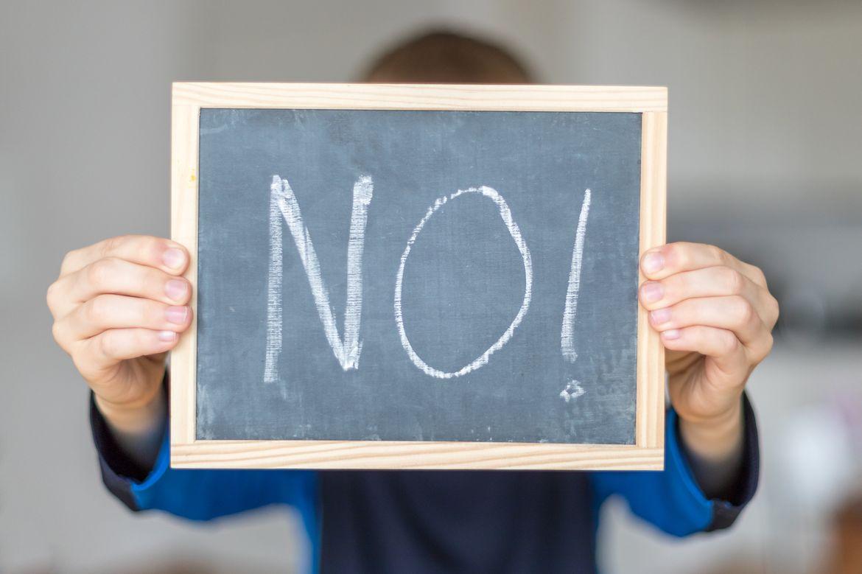 "Chalkboard sign saying ""No!"""