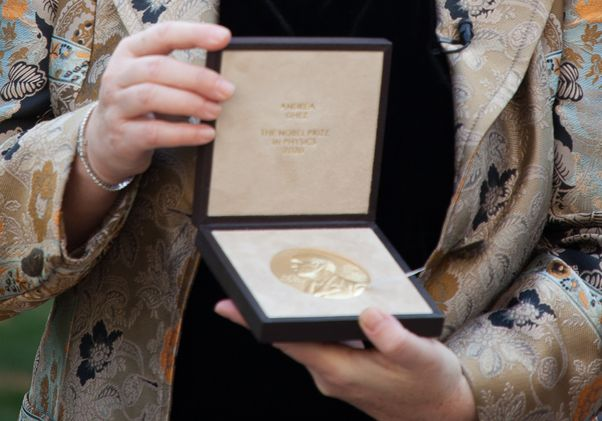 Click to open the large image: Ghez with Nobel medal