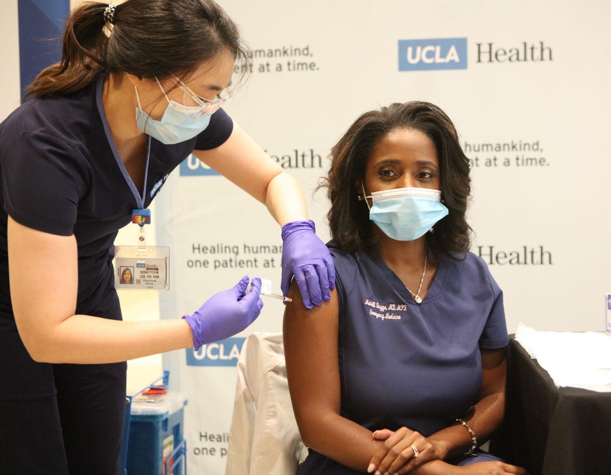 Dr. Medell Briggs-Malonson receives vaccine