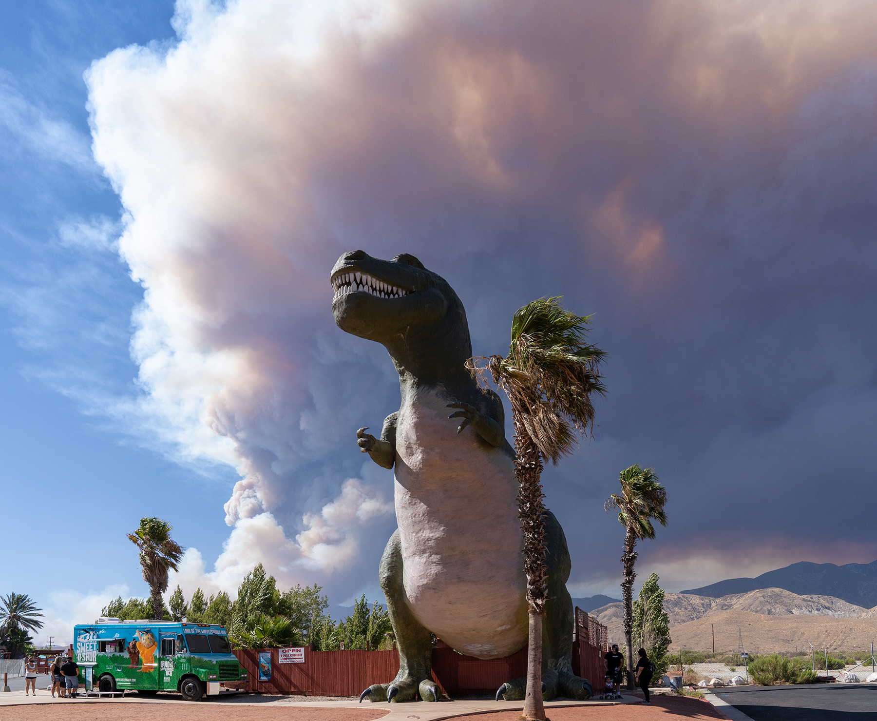 This year's Apple fire, which affected Riverside and San Bernardino counties, created a smoky backdrop to the Cabazon Dinosaurs roadside attraction.