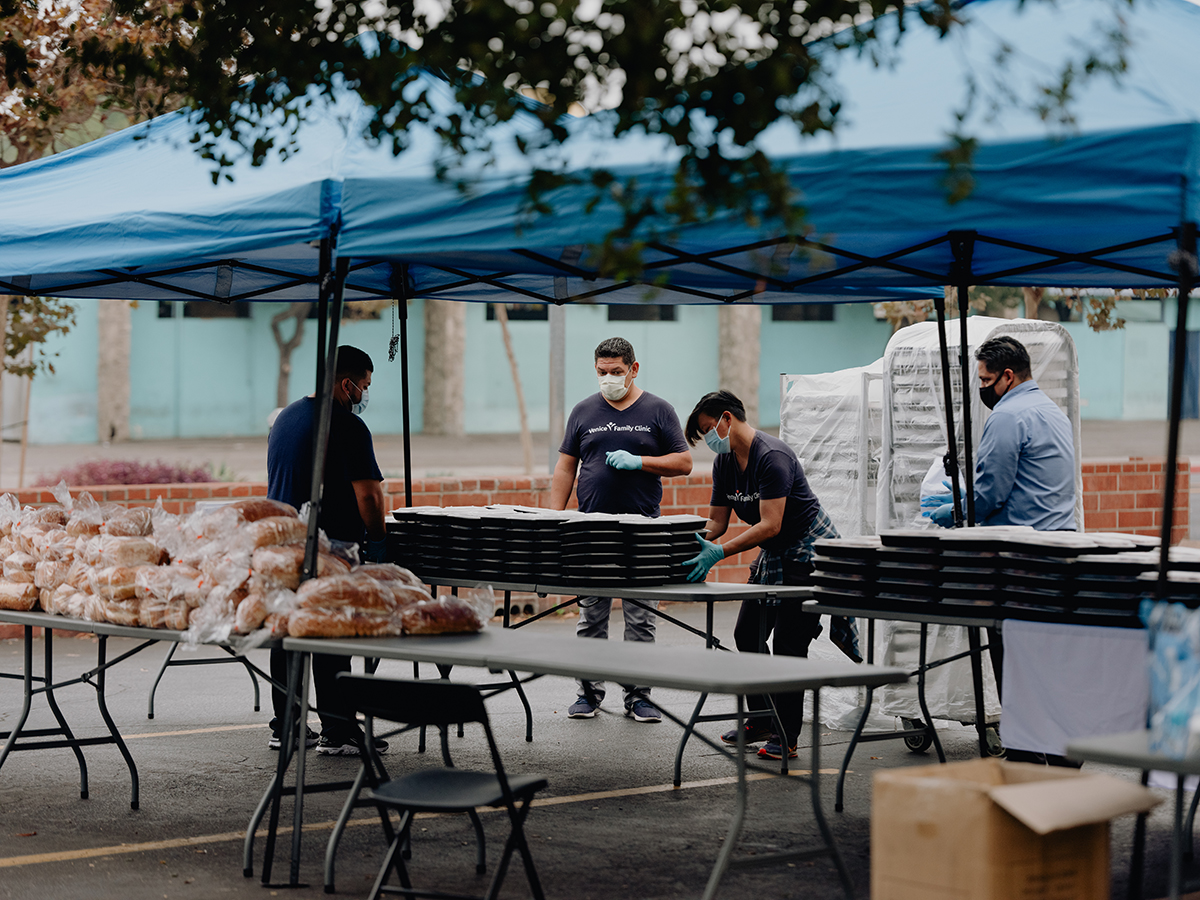 UCLA Dining and Venice Family Clinic workers prepare for the day's food distribution at the Clinic's center in Santa Monica.