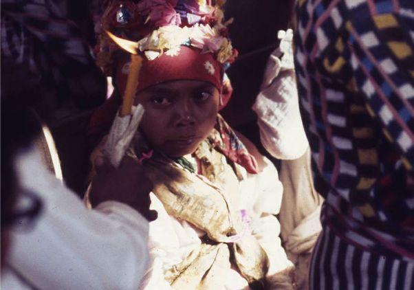 Click to open the large image: Mayan Boy During Semana Santa