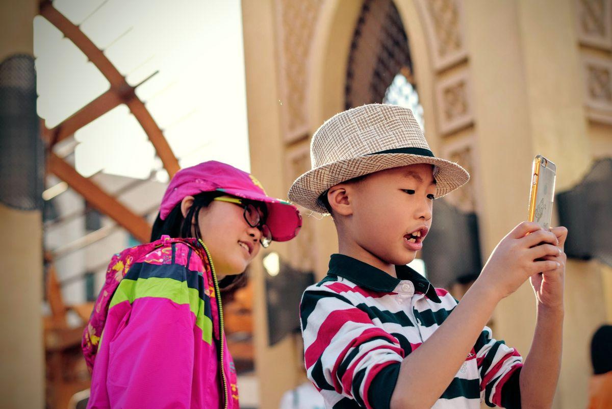 Kids looking at phone