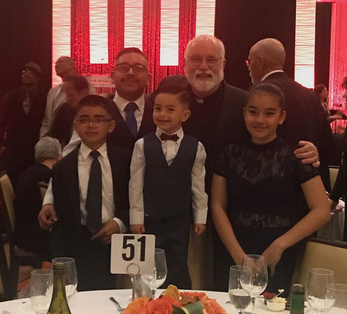 Romen Lopez with kids and Father Greg Boyle