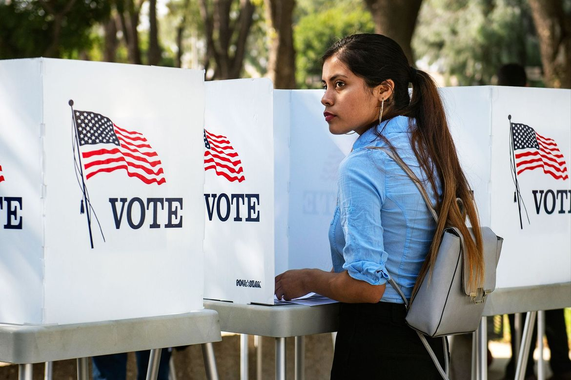 Woman at a voting booth