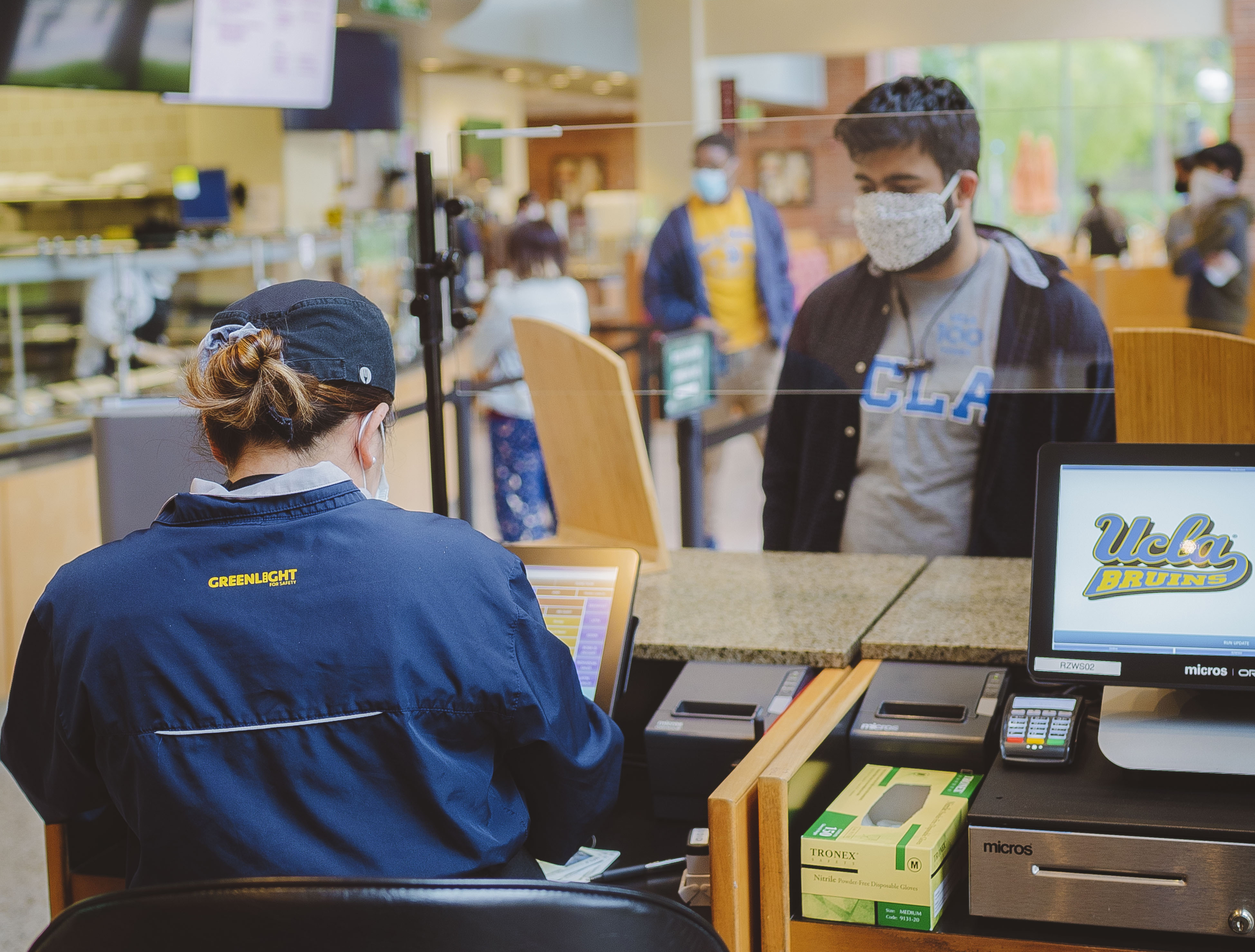 Students and staff in the dining halls adapted to wearing face masks and speaking through the plexiglass barriers.