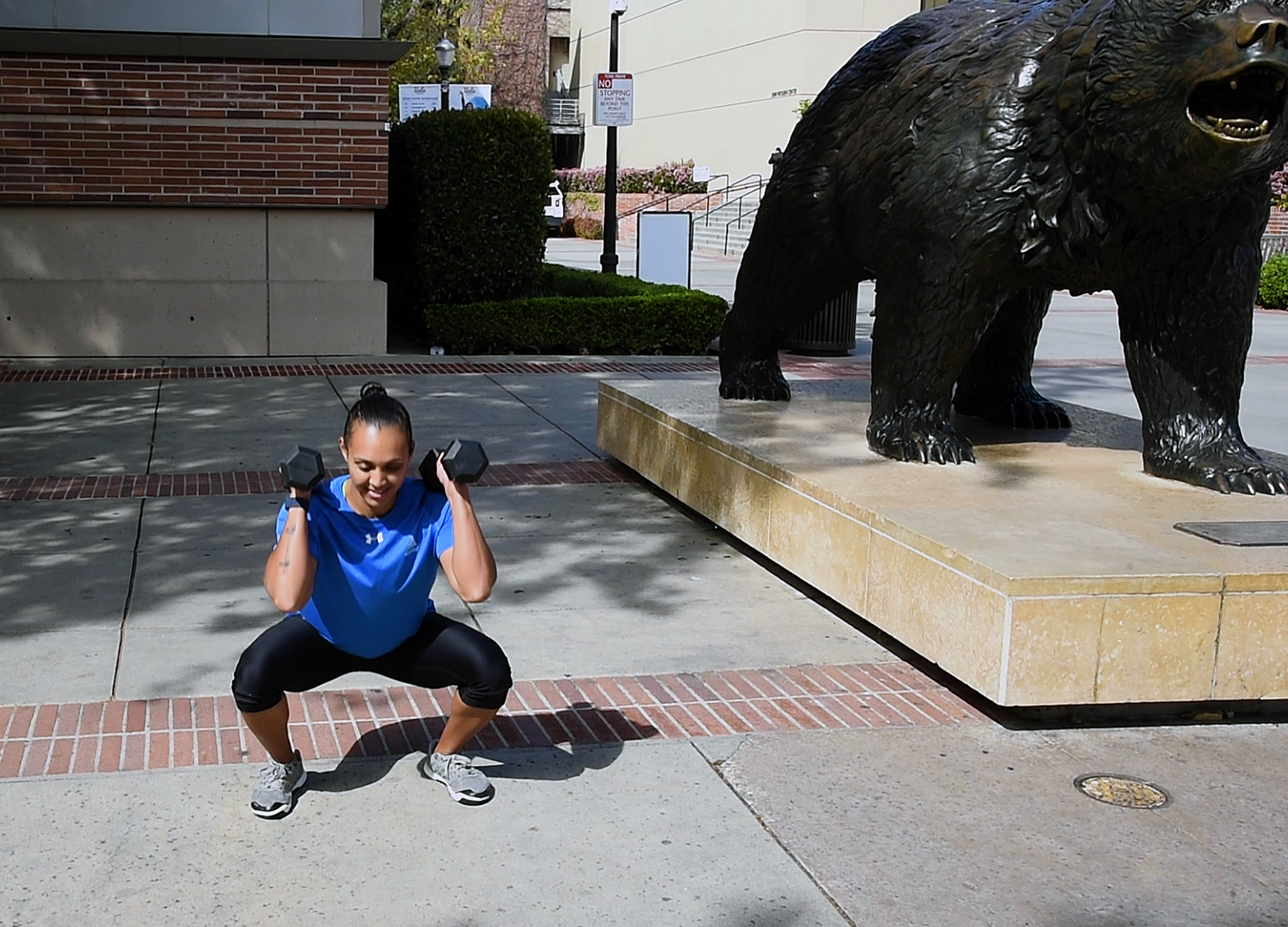 Exerciser next to The Bruin statue
