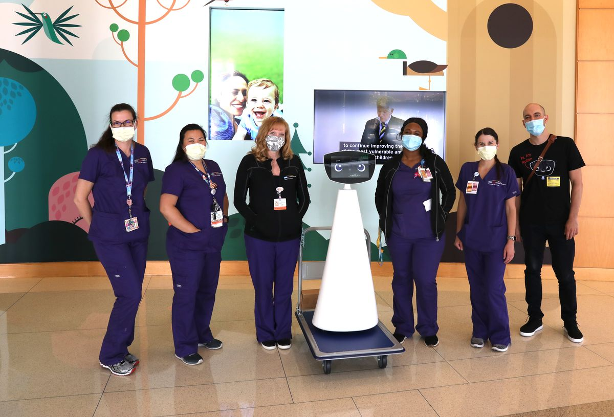 Robin the robot with members of hospital staff