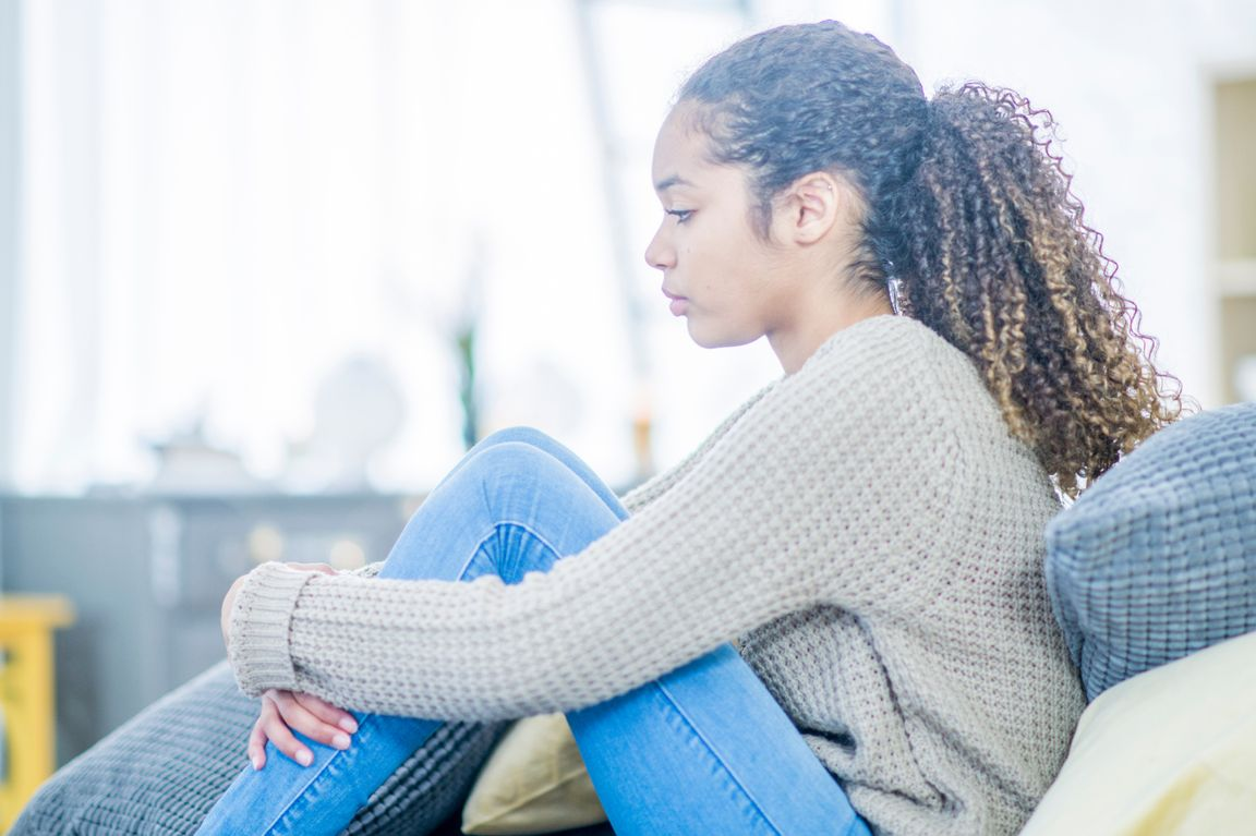 Teen girl sitting