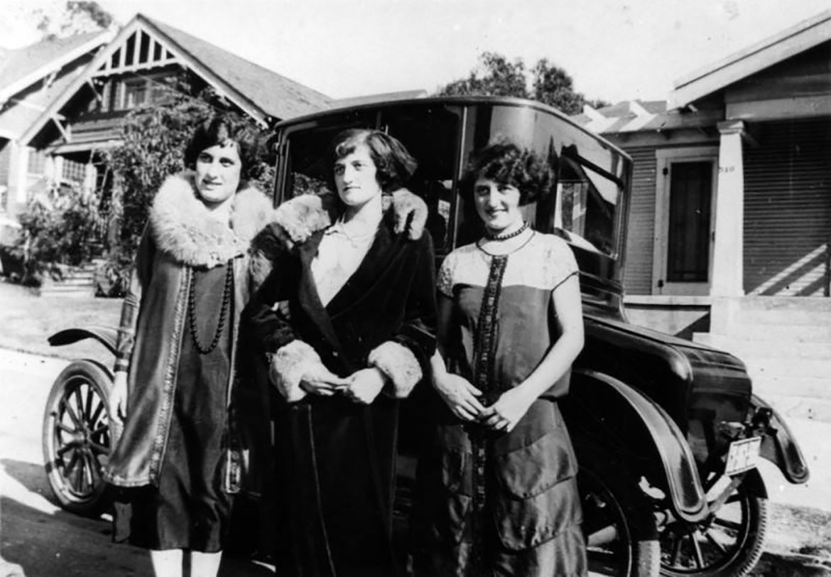 This is a photo of Mollie Silverman (left) and friends in front of automobile on Malabar Street, ca. 1918.