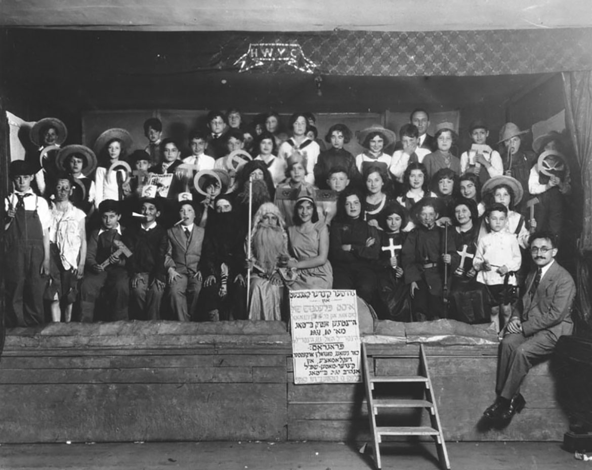 This is a photo of students of the Jewish People's Fraternal Order Yiddish school performing their annual Purim play at the Cooperative Center in 1938.