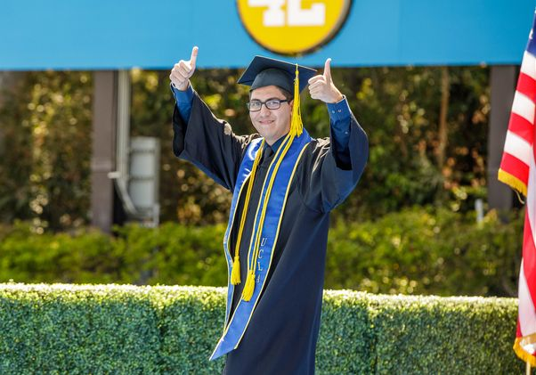 Click to open the large image: UCLA Commencement 2021 - student thumbs up